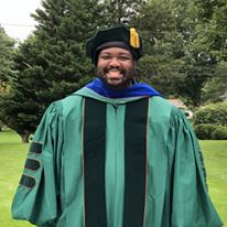 Pastor Marcus Jerkins in Cap and Gown
